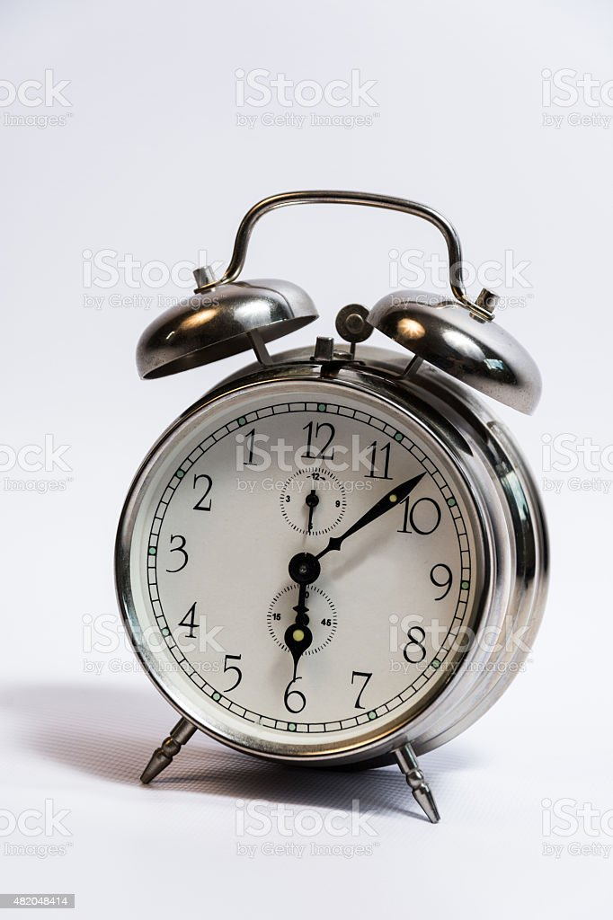 Vintage Retro-Styled Silver Alarm Clock With White Background. stock photo