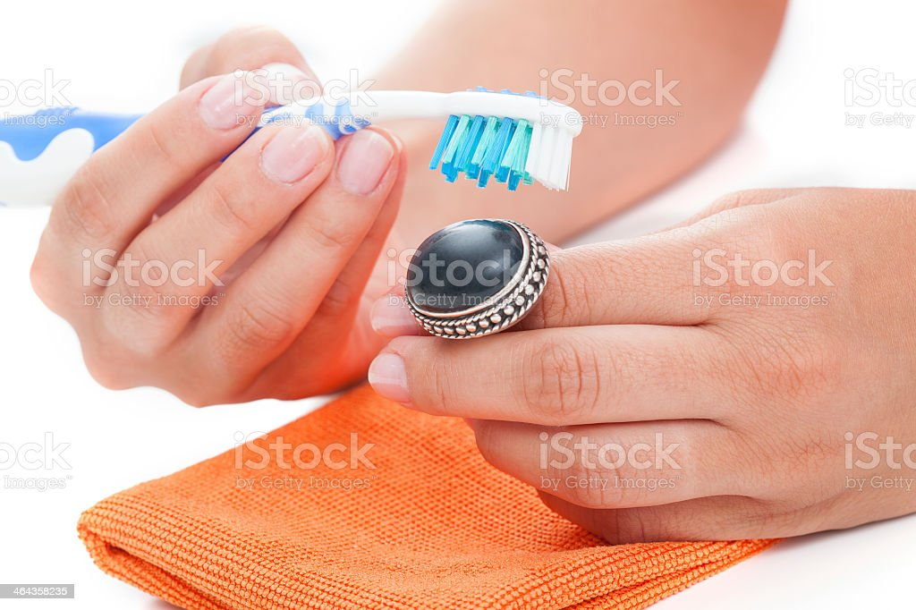 Vintage ring cleaning stock photo