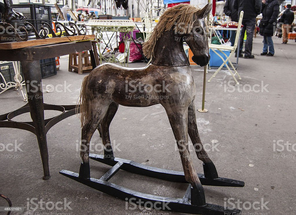 Vintage rocking horse at flea market in Paris. royalty-free stock photo