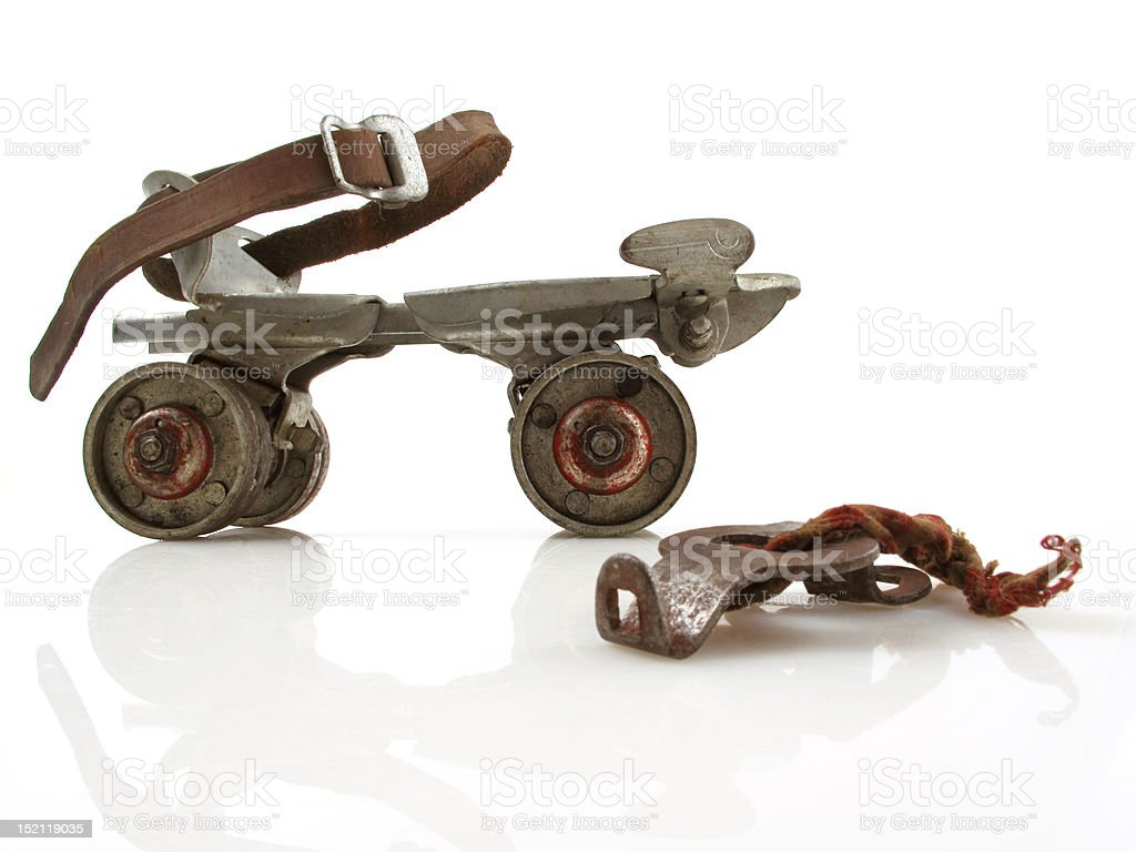 Vintage Roller Skate with Key stock photo