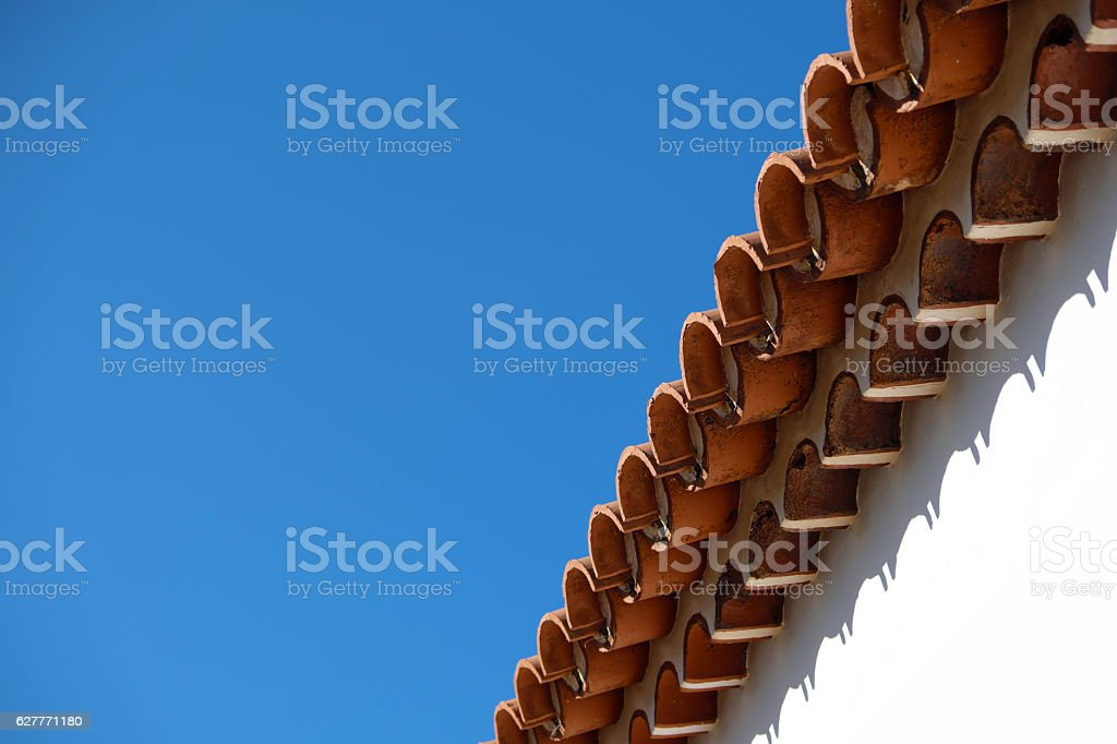 vintage roof tiles, blue sky, copy space stock photo
