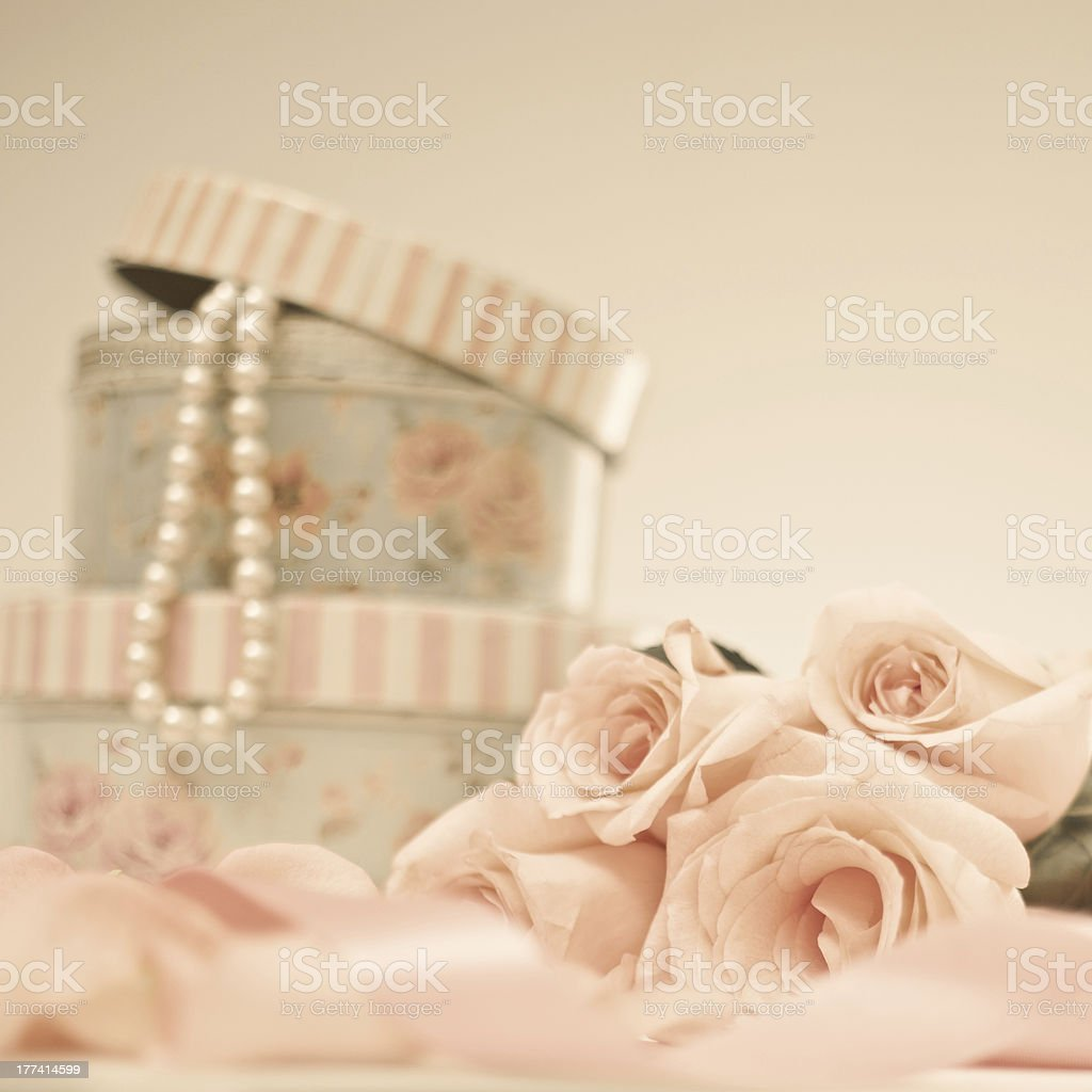 Vintage roses and pearl necklace royalty-free stock photo