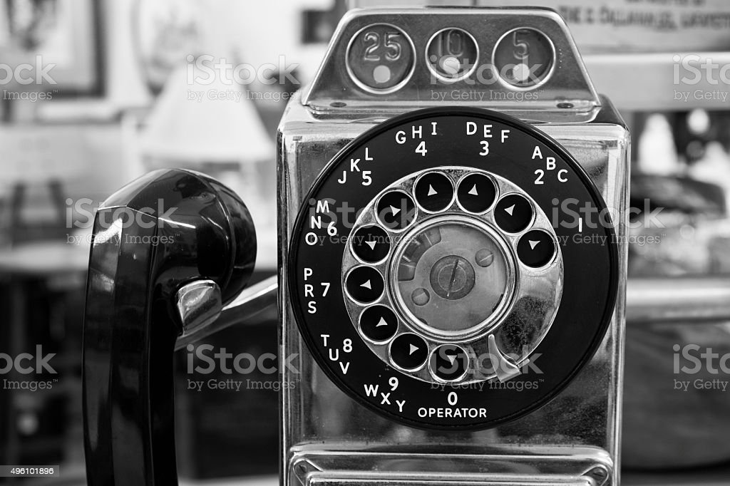 Vintage Rotary Pay Phone - Old Pay Telephone stock photo