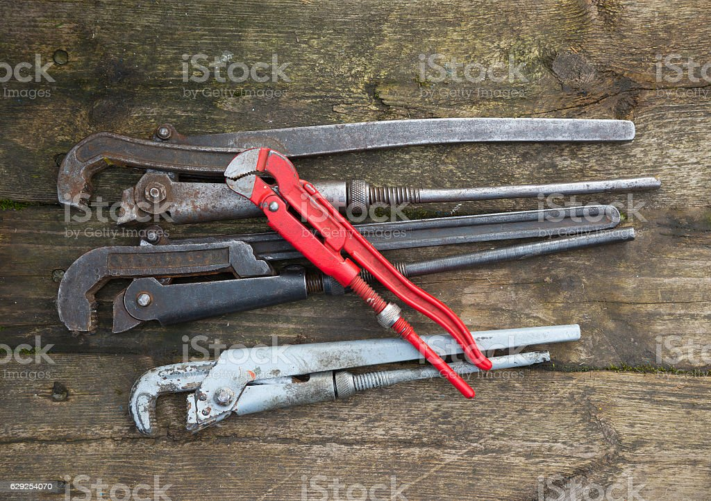 Vintage rusted pipe wrenches stock photo