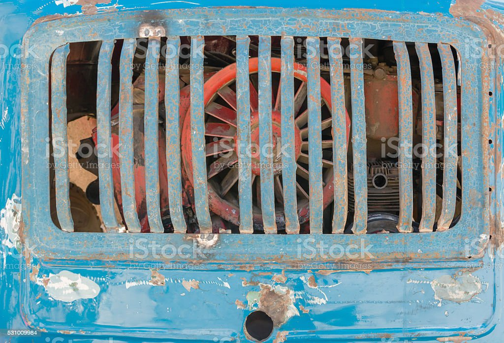 Vintage rusty grill of blue truck car stock photo