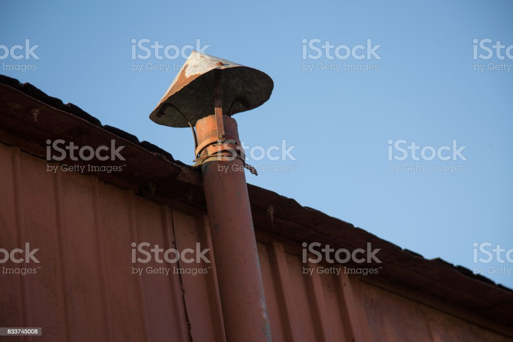 Vintage rusty pipe cone background stock photo