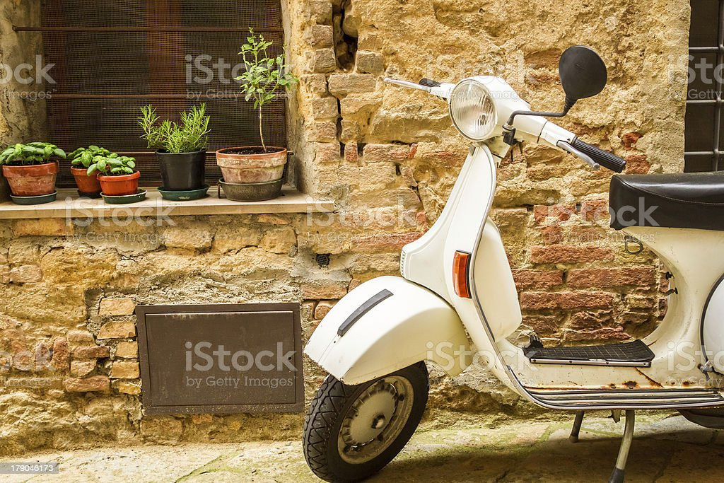 Vintage scene with Vespa on old street royalty-free stock photo