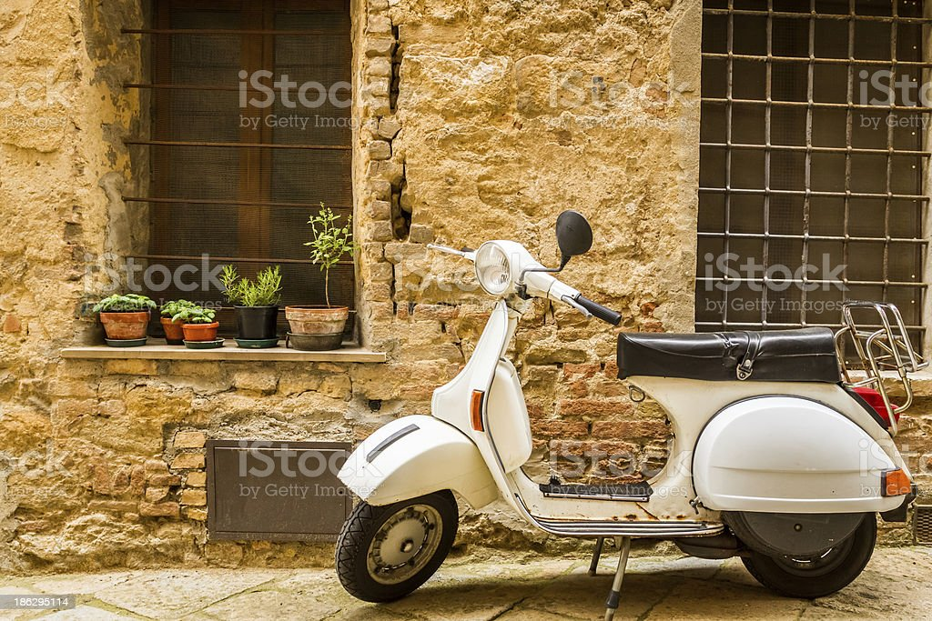 Vintage scene with Vespa on old street stock photo