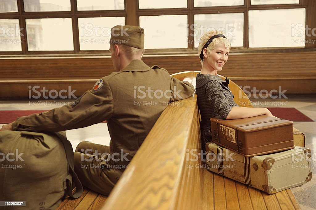Vintage Scene With Woman And Soldier Waiting At Bus Station royalty-free stock photo