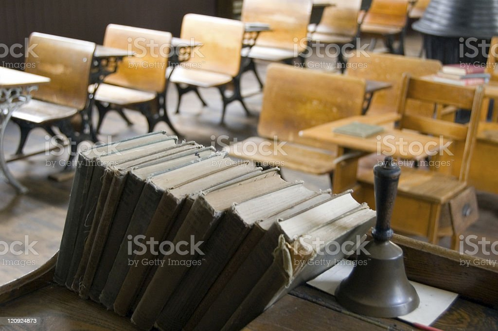 Vintage School Books, Bell, and Desks stock photo