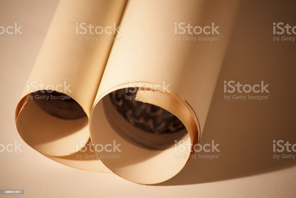 Vintage scroll against a sepia background royalty-free stock photo