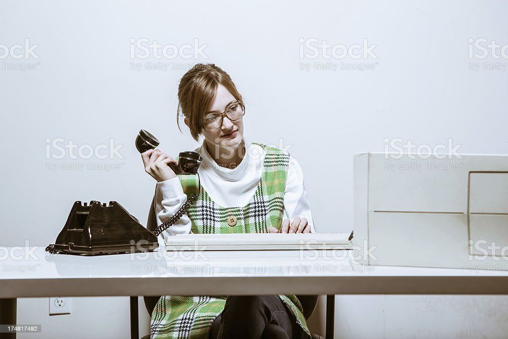 Vintage Secretary on Phone and Computer royalty-free stock photo