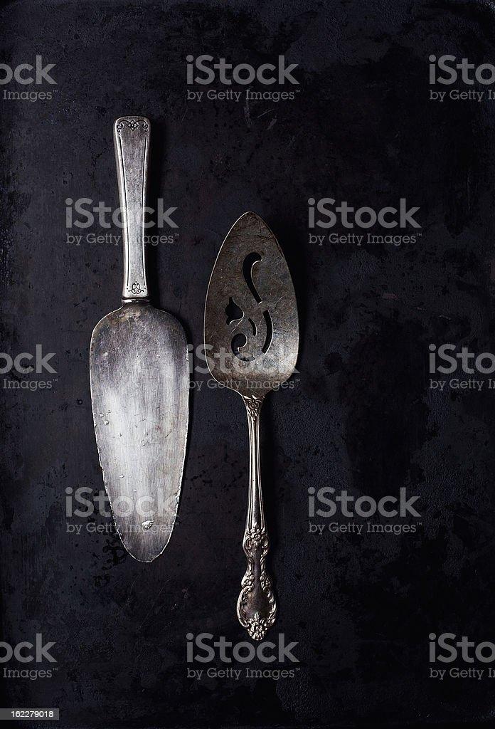 Vintage Serving Spatulas on Dark Background royalty-free stock photo