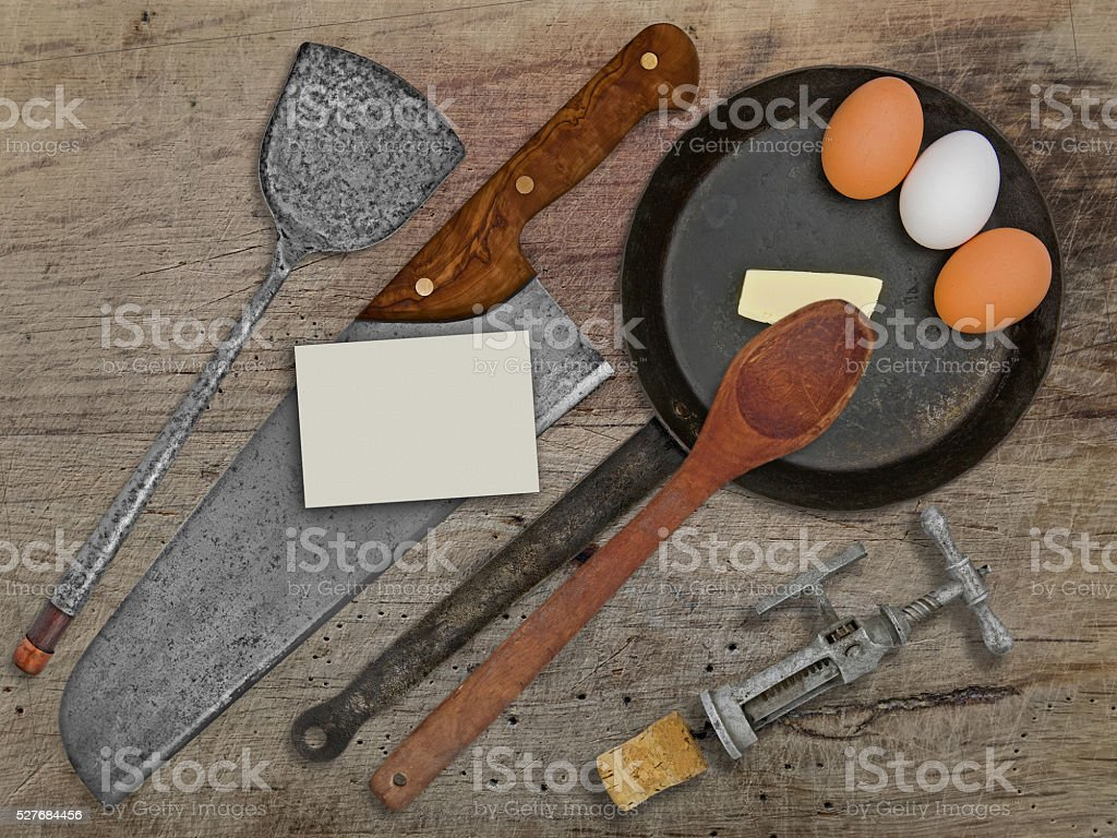 vintage set for frying eggs over wooden table stock photo
