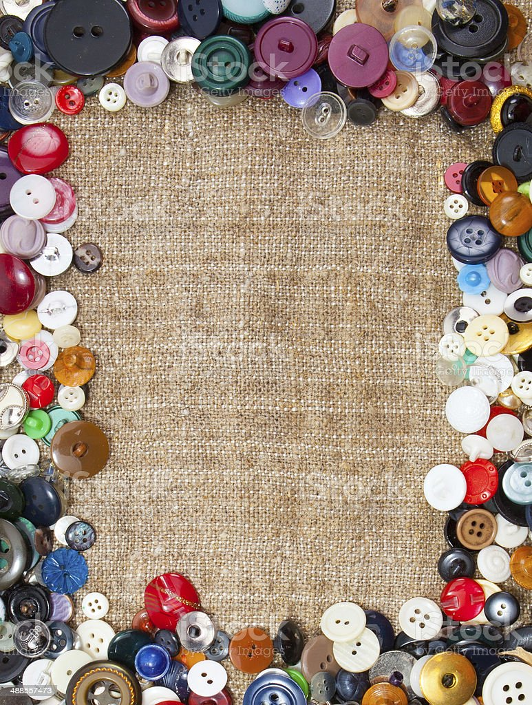 Vintage Sewing Buttons Framing Fabric Background royalty-free stock photo