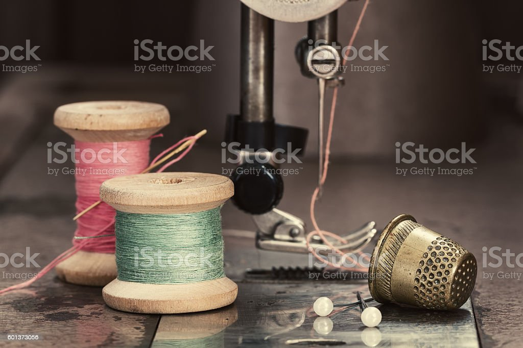 Vintage sewing thread on sewing machine stock photo