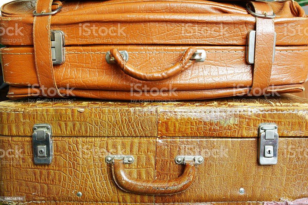 Vintage shabby old suitcase yellow stock photo