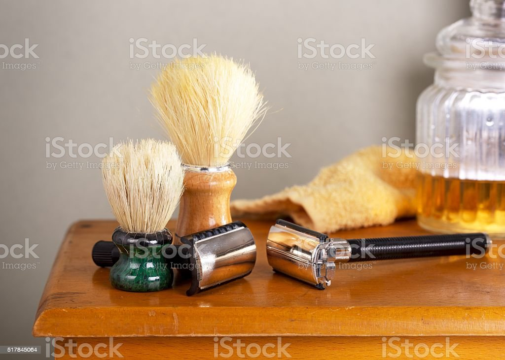 Vintage shaving tools on a wooden table stock photo