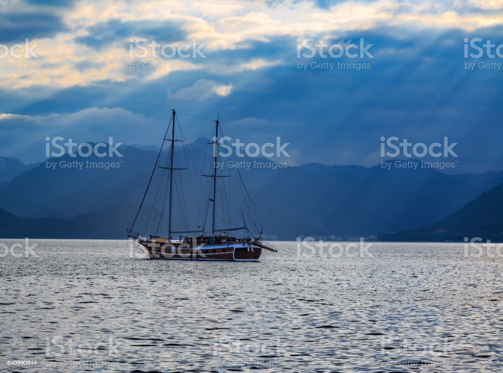 Vintage ship sailing with sun rays. stock photo
