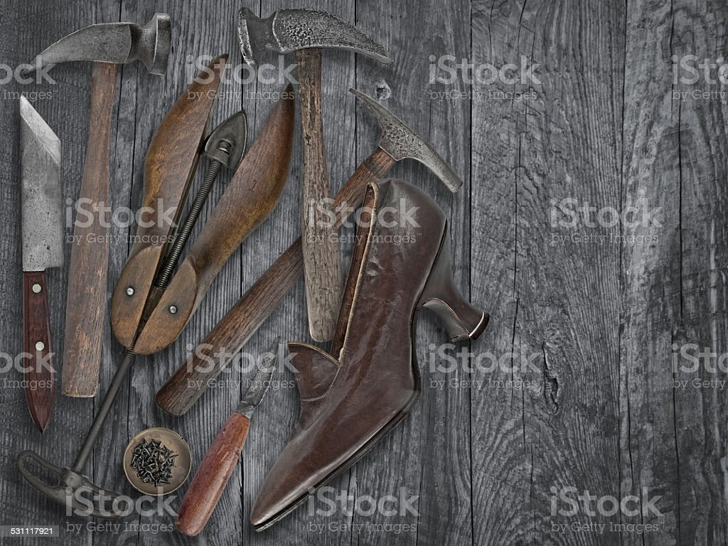 vintage shoemakers tools and shoe stock photo