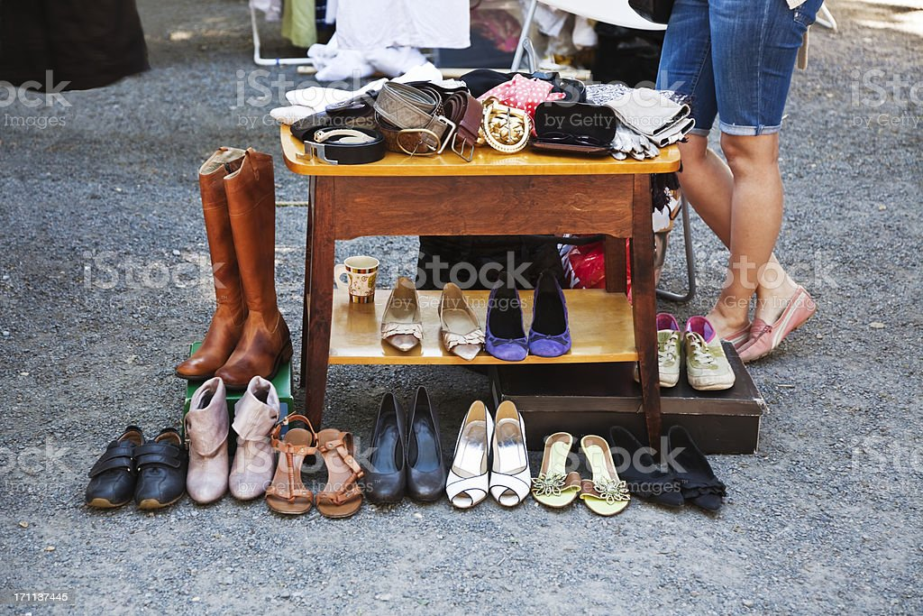 Vintage shoes and table at a flea market. royalty-free stock photo