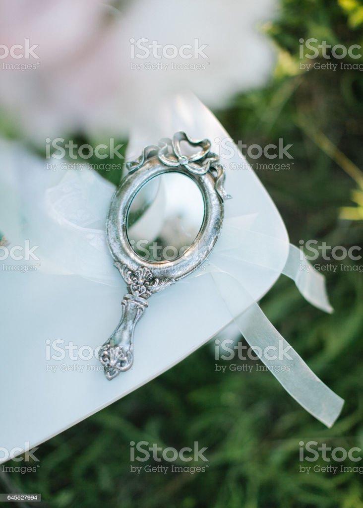 vintage silver pocket mirror close up stock photo