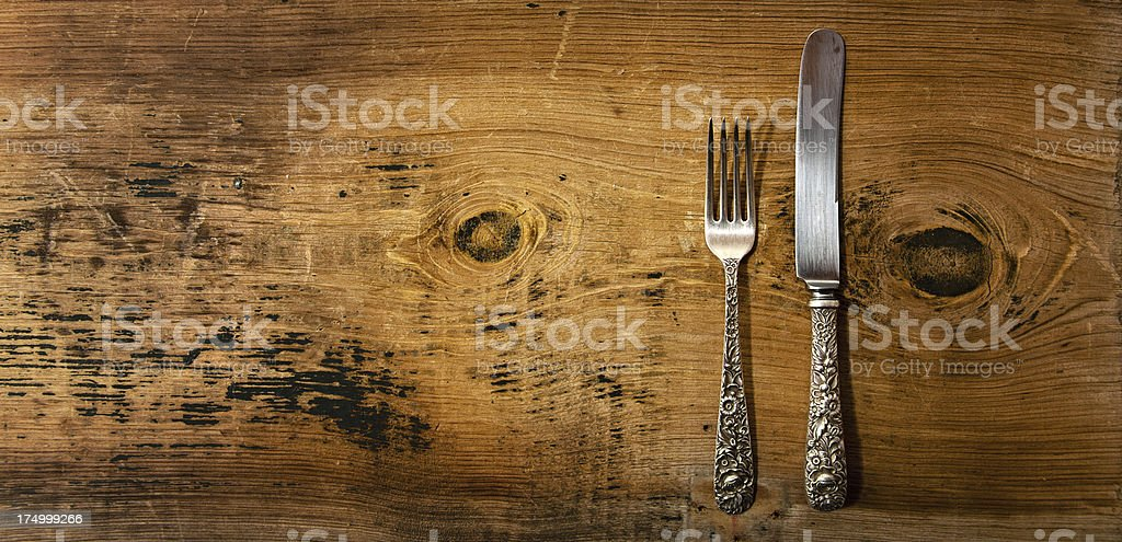Vintage Silverware on Rustick Grunge Wooden Background royalty-free stock photo