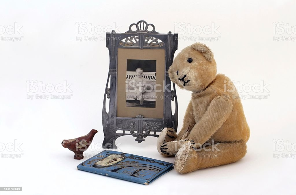 Vintage sitting  mohair teddy bear with picture of young boy. stock photo