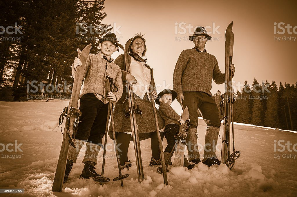 Front view of skiing family using equipment from 1950\'s. Location:...