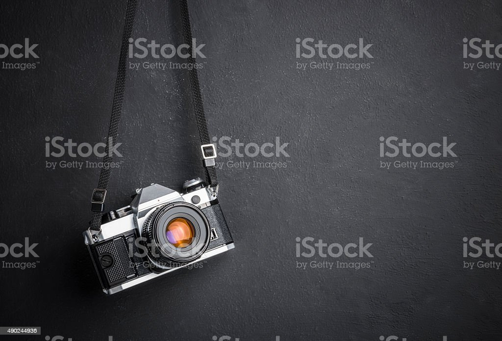 Vintage SLR camera hanging on the wall stock photo
