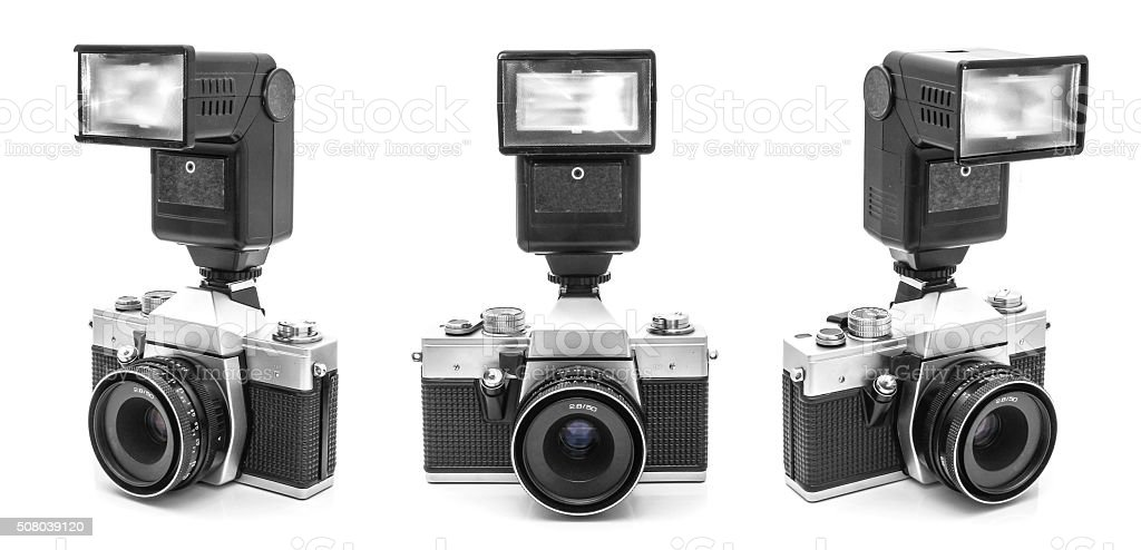 Vintage SLR camera with flash stock photo