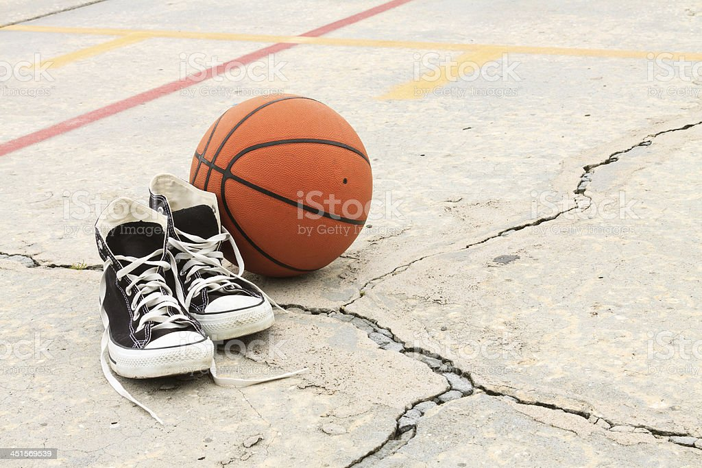 Vintage Sneakers And Basketball In Inner City Playground stock photo