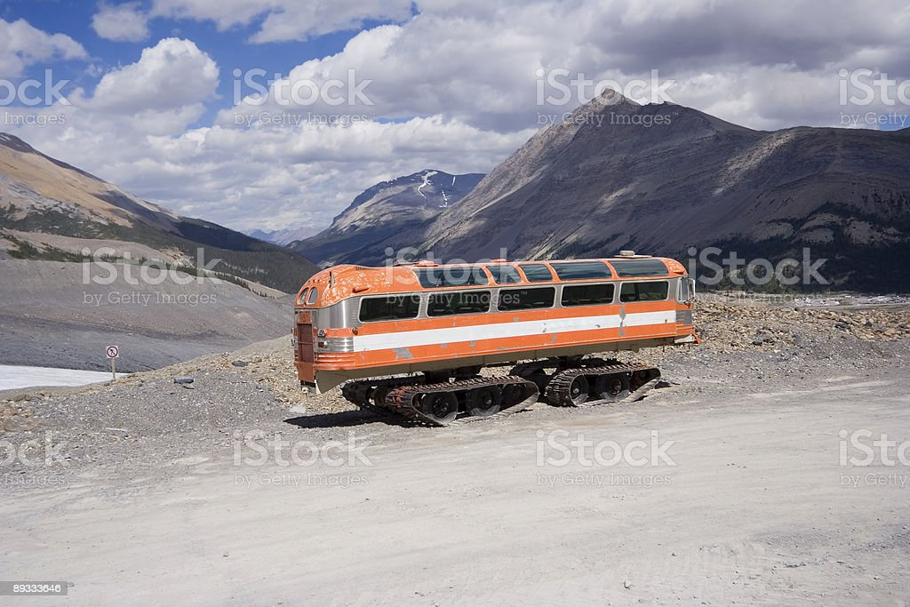 vintage snowmobile in the rocky mountains royalty-free stock photo
