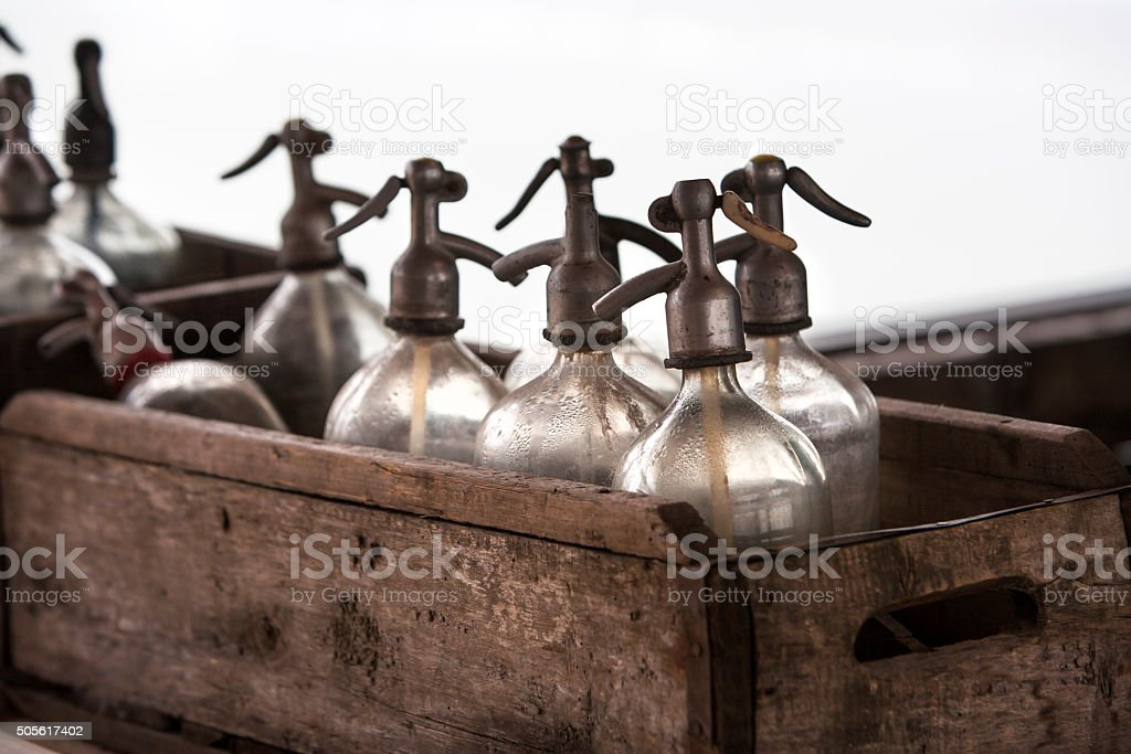 Vintage soda bottles in old wooden crates stock photo