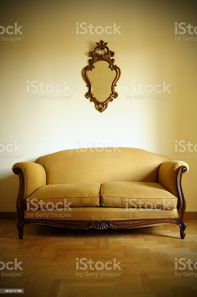 Vintage Sofa and Old Gold Mirror royalty-free stock photo