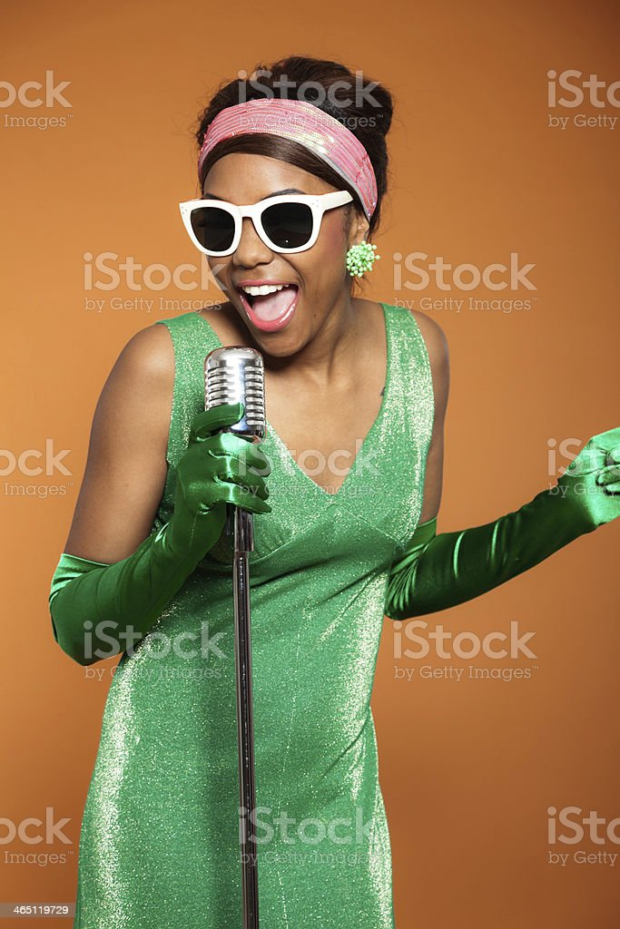 Vintage soul funk woman singing. Black african american. stock photo