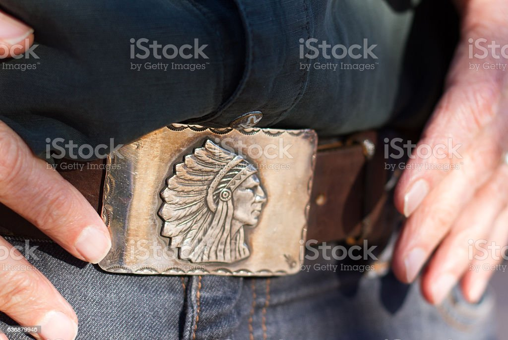 Vintage Southwest Silver Belt Buckle, Man's Hands (Close-Up) stock photo