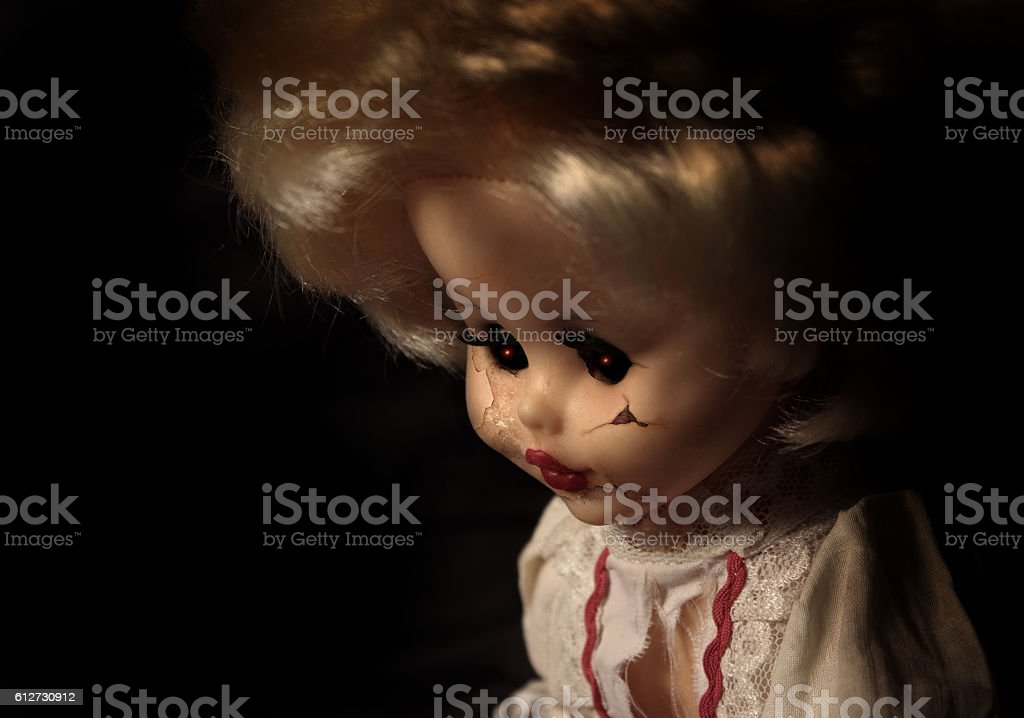 Vintage spooky doll stock photo