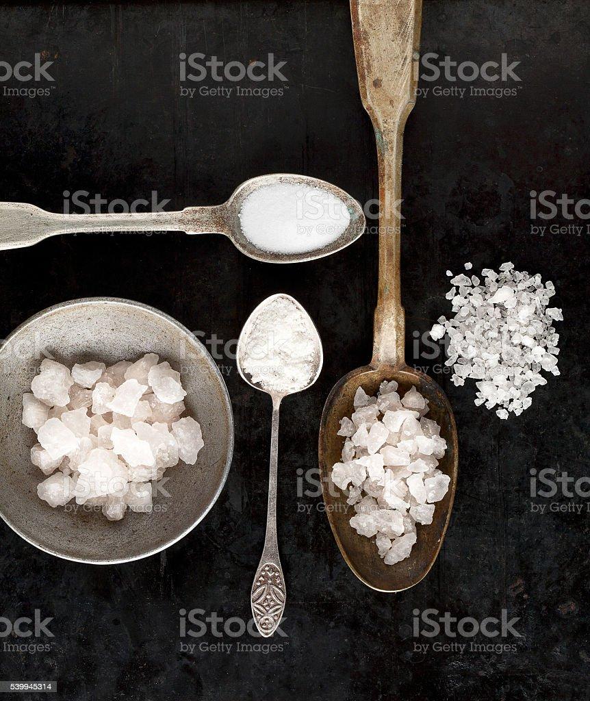 vintage spoons of salt stock photo