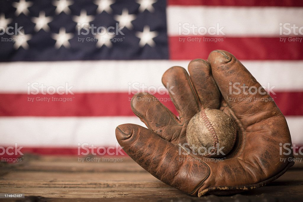 Vintage Sports Equipment in Front of American Flag royalty-free stock photo