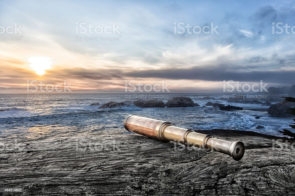 Vintage Spyglass on log stock photo