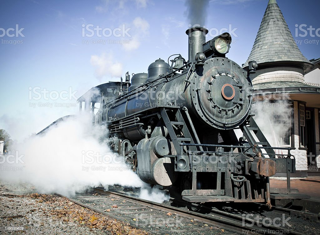 Vintage Steam Locomotive On a Clear Day At Train Platform royalty-free stock photo