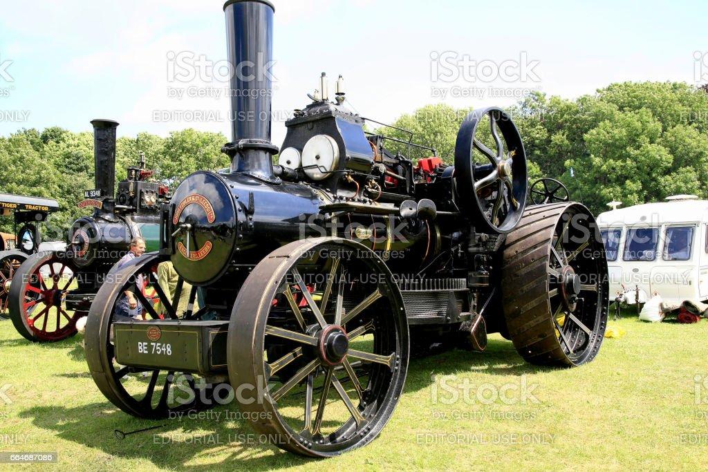 Vintage steam plough machine. stock photo
