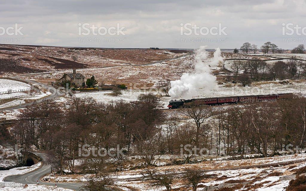 Vintage steam train in winter, Goathland, Yorkshire, UK. stock photo