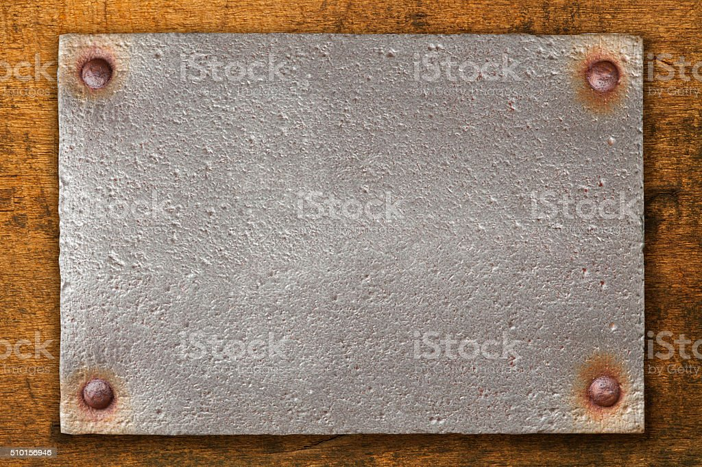 vintage steel plate on wooden background stock photo