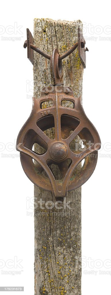Vintage steel pulley attached to weathered post-isolated on white royalty-free stock photo