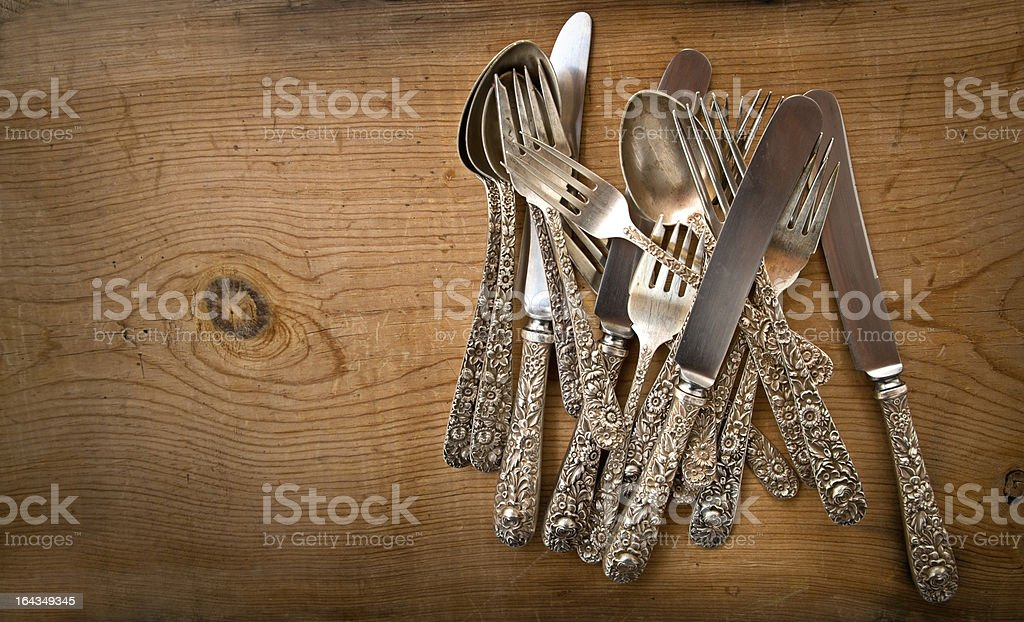 Vintage Sterling Silverware on Rustick Grunge Wooden Background royalty-free stock photo