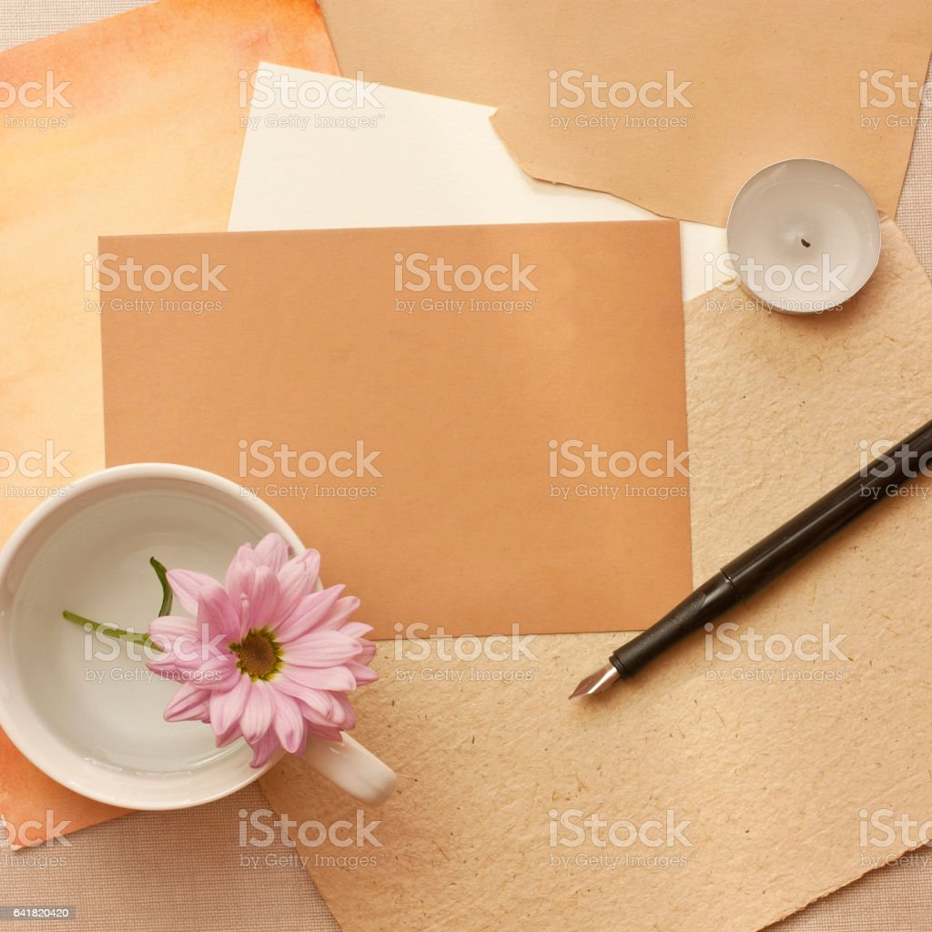 Vintage still life with postcard, chrysanthemum, ink pen, candle stock photo