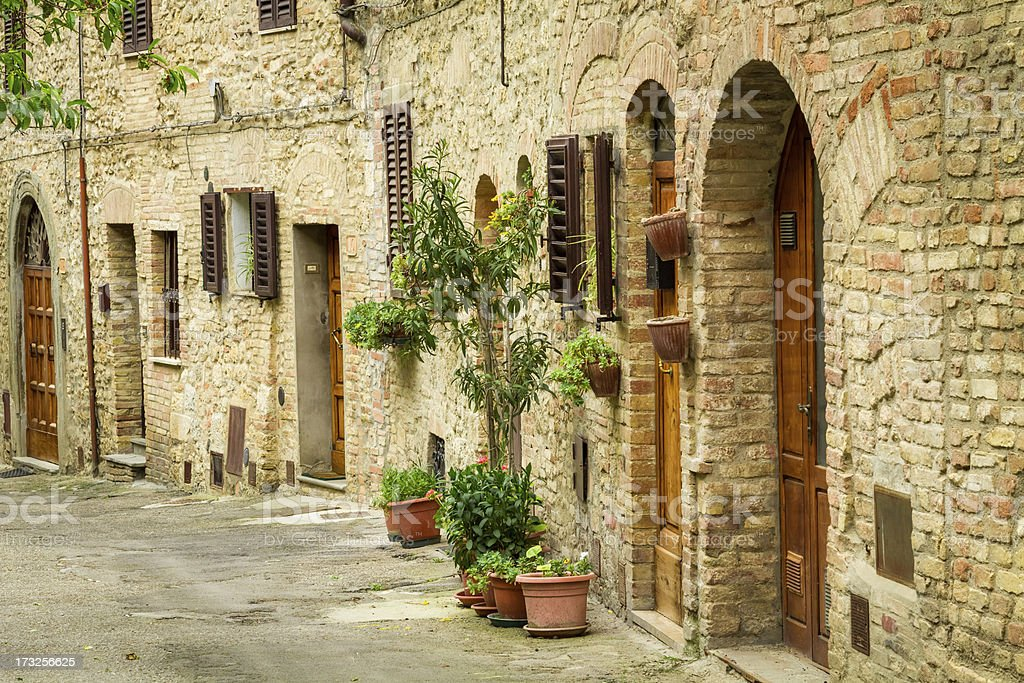 Vintage street decorated with flowers, Italy royalty-free stock photo