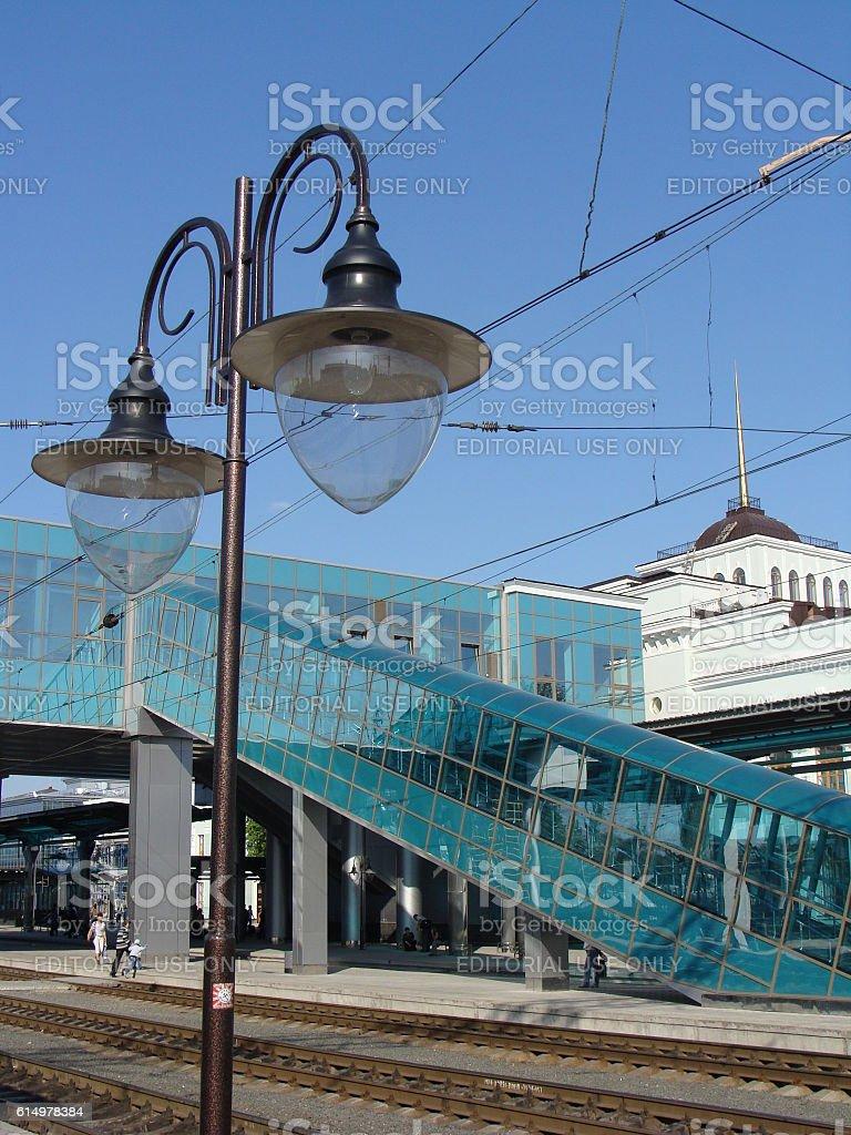 Vintage Stye Lantern on a Modern Railway Station Platform stock photo